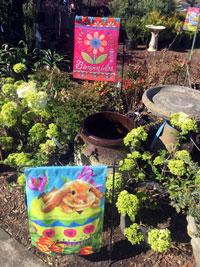 Spring flags bird baths pottery plants