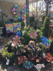 shrubs with colorful garden art
