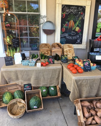 farmer's market set up with locally grown produce