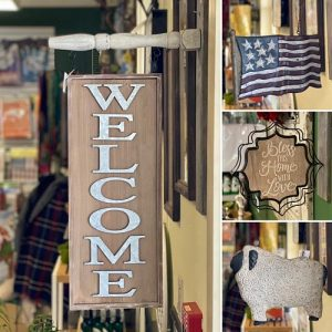 welcome and american flag and other signs